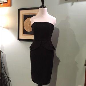 WHBM Black strapless peplum dress.